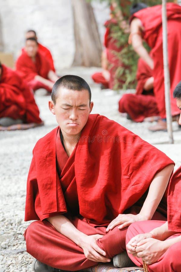 Dharma debating at Sera monastery,Tibet. Lhasa,Tibet-8 Apr 2013;Dharma debating,Tibetan buddhist lama are debating with aggressive manner in courtyard at Sera stock photography