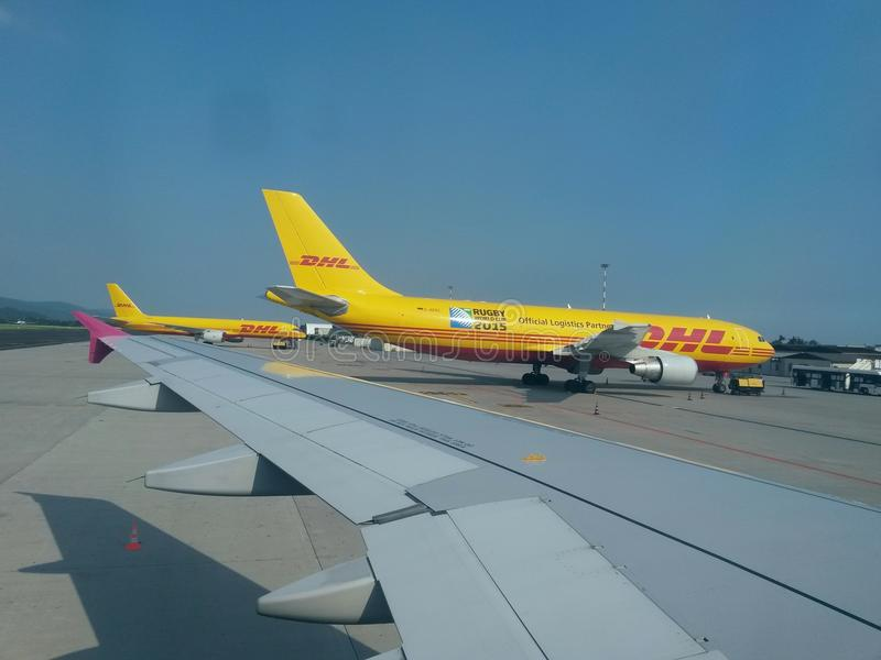 DHL aircrafts. ORIO AL SERIO (BERGAMO), ITALY - CIRCA JULY 2014: DHL Deutsche post aircrafts parked at the airport. DHL is one of the leading private mail stock photos