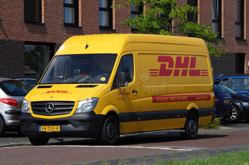 DHL delivery delivery van - Mercedes Sprinter. Almere Poort, Flevoland, The Netherlands - August 13, 2015: DHL delivery van parked by the side of the road in stock image