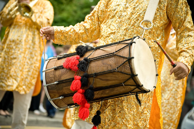 Dhol drum. Musician playing a traditional asian dhol drum stock photo