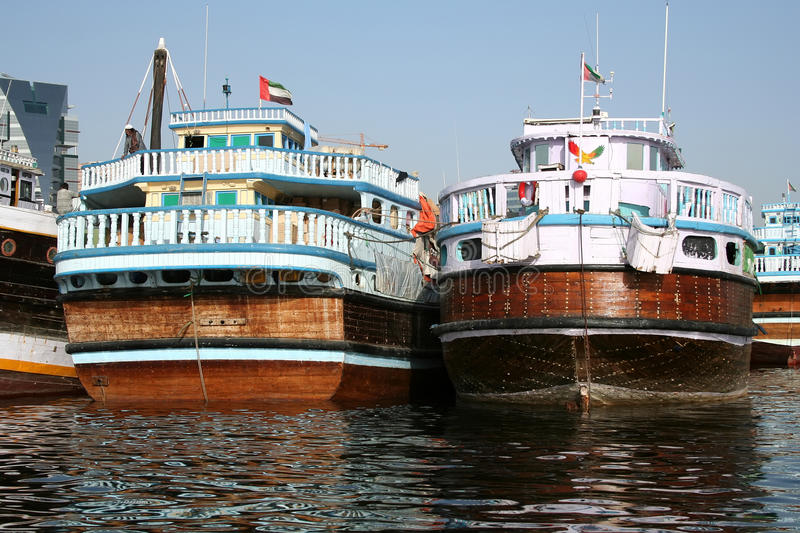 Dhows on Dubai Creek. Dhows moored on the Dubai Creek in the U.A.E royalty free stock photography