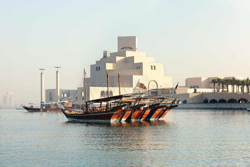 Dhows and museum. Dhows moored in front of the Museum of Islamic Art in Doha, Qatar royalty free stock photos