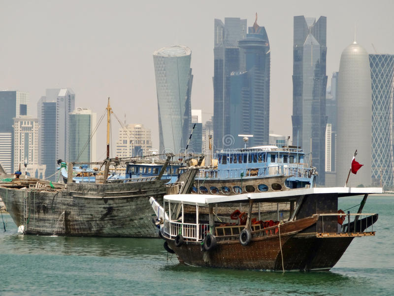 Dhows in qatar. Some dhows moored in the port of doha in qatar royalty free stock images
