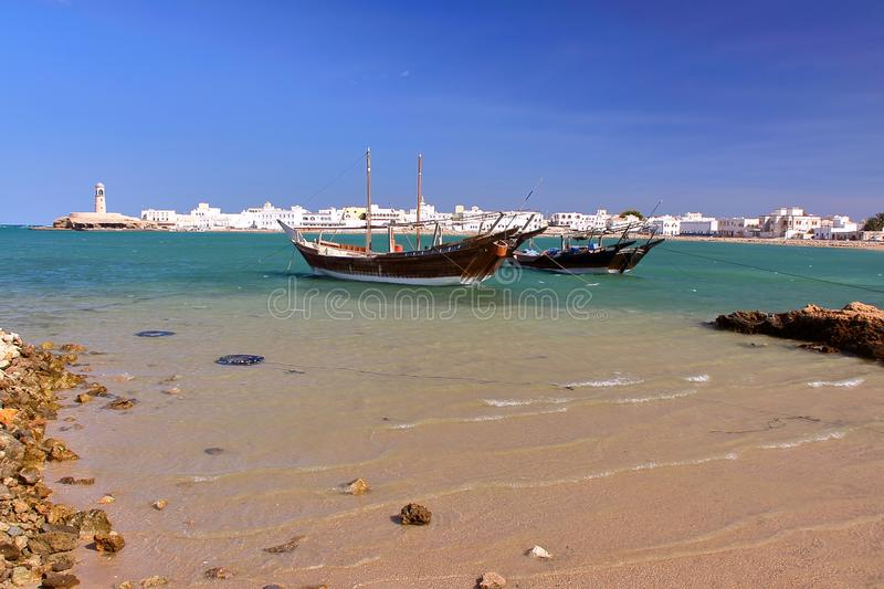 Dhows traditional sailing and fishing boats at the Old Harbor in Ayjah, Sur. Oman royalty free stock images