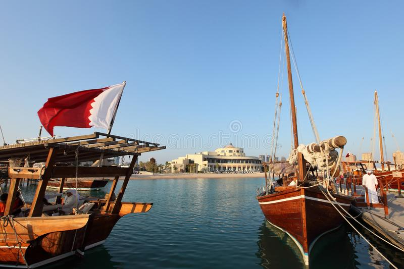 Dhows and traditional small wooden boats at Dhow festival royalty free stock photo