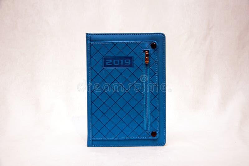 Diário azul em um fundo branco imagens de stock royalty free