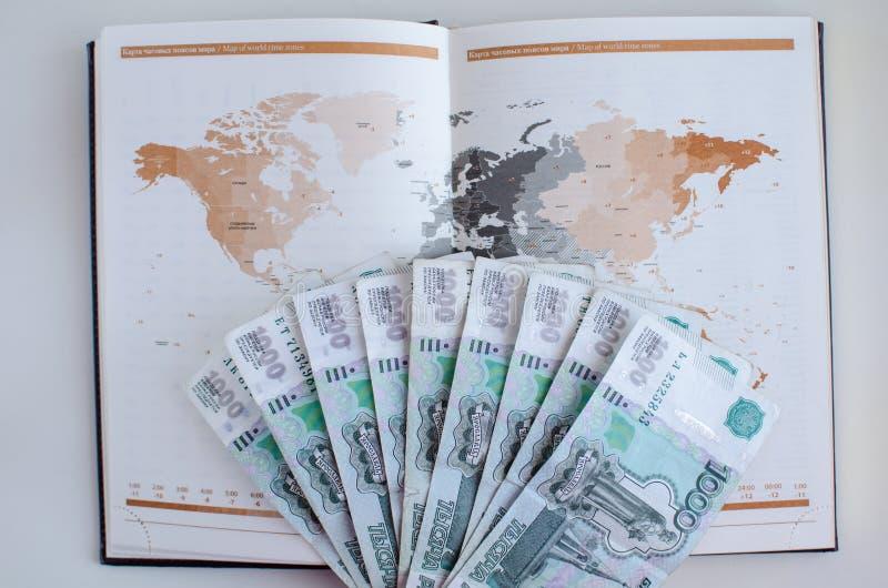Diário e cédulas no fundo branco fotos de stock royalty free