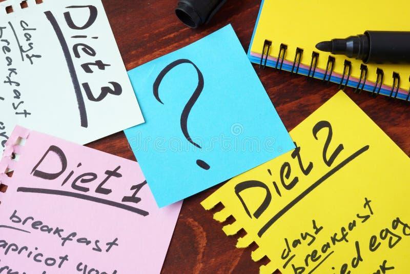 Diät-Pläne geschrieben auf Seiten stockbilder