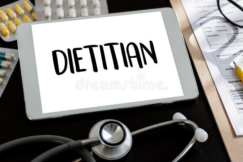 DIÄTETIKER- und Ernährungswissenschaftlerdoktor oder Diätetiker und Diätetiker Pro lizenzfreie stockfotografie
