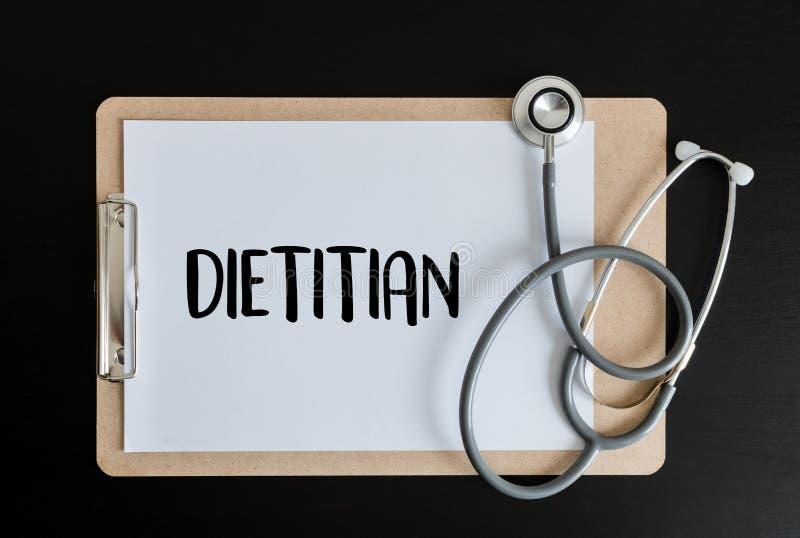 DIÄTETIKER- und Ernährungswissenschaftlerdoktor oder Diätetiker und Diätetiker Pro lizenzfreie stockbilder