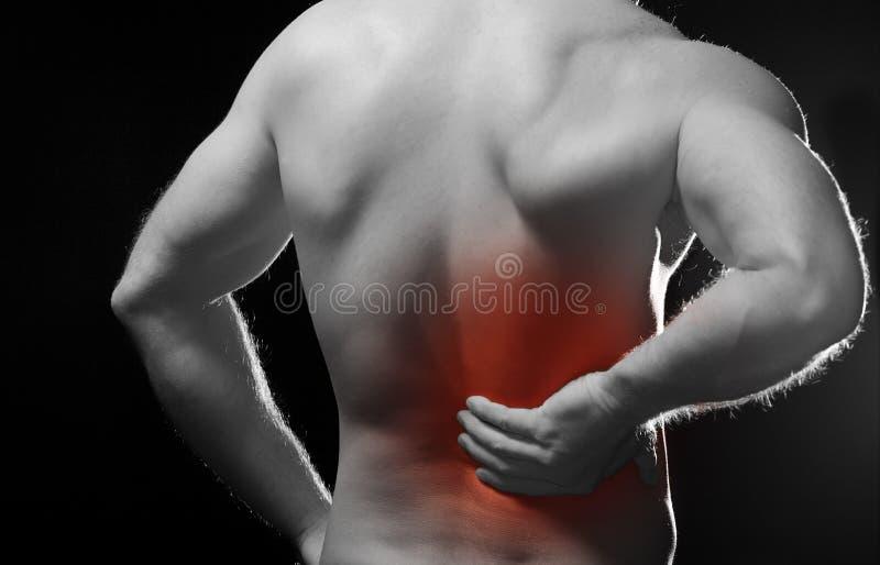 Di dolore parte posteriore dentro fotografie stock libere da diritti