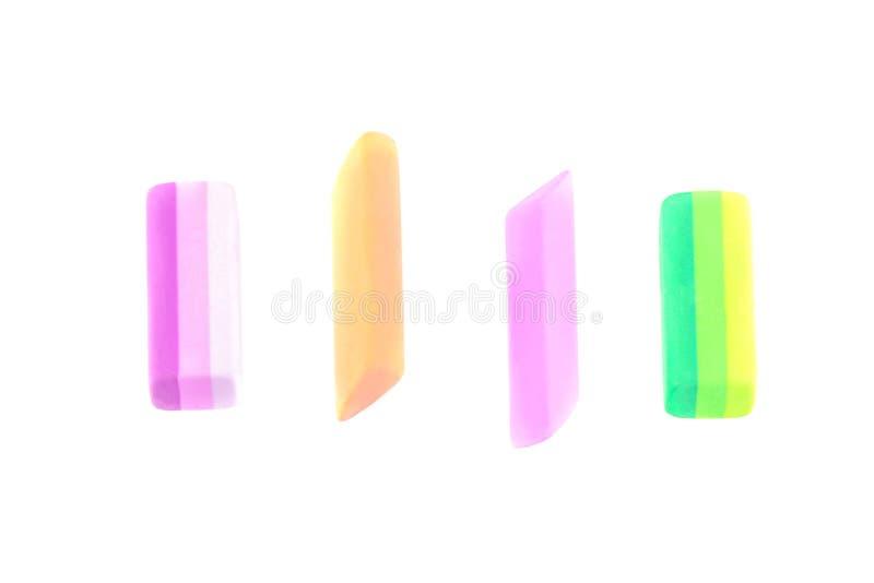 di gomme colorate multi su un fondo isolato bianco Rifornimenti di banco fotografie stock libere da diritti