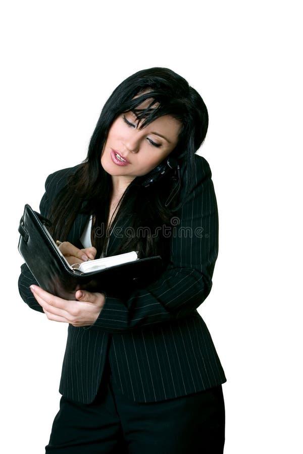 Di impiegato che prende un appuntamento del diario fotografie stock libere da diritti