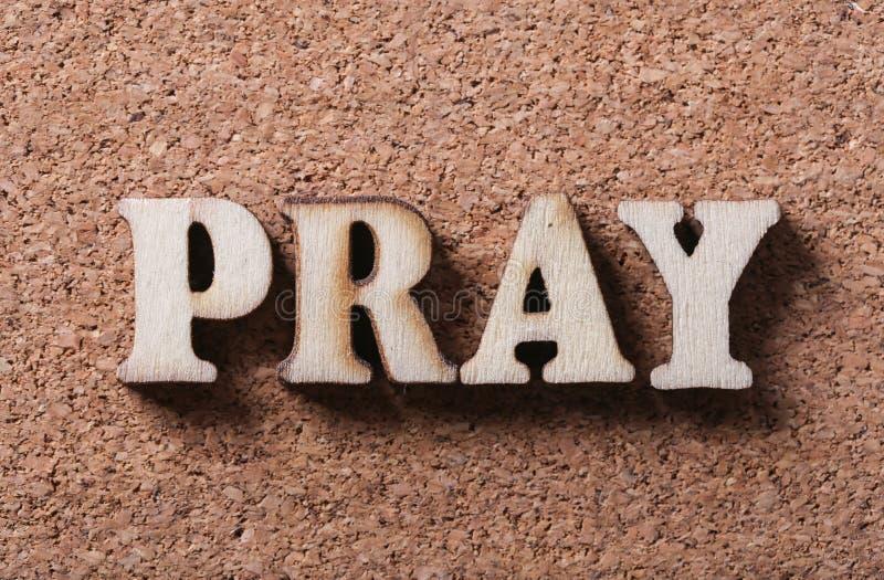 Di legno preghi il testo fotografie stock