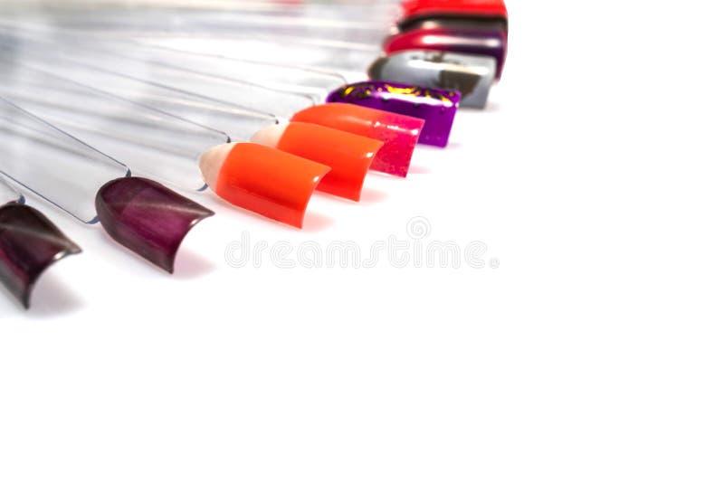 di modelli colorati Multi dello smalto su fondo bianco immagine stock libera da diritti