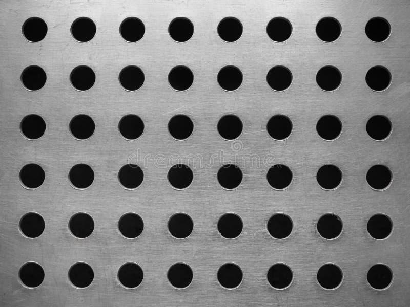 Di piastra metallica con molti fori circolari fotografia stock