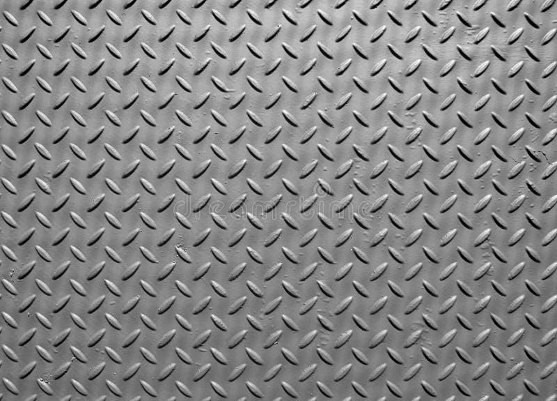 Di piastra metallica d'acciaio grigio con struttura del modello del diamante industriale e della superficie dipinta immagine stock libera da diritti