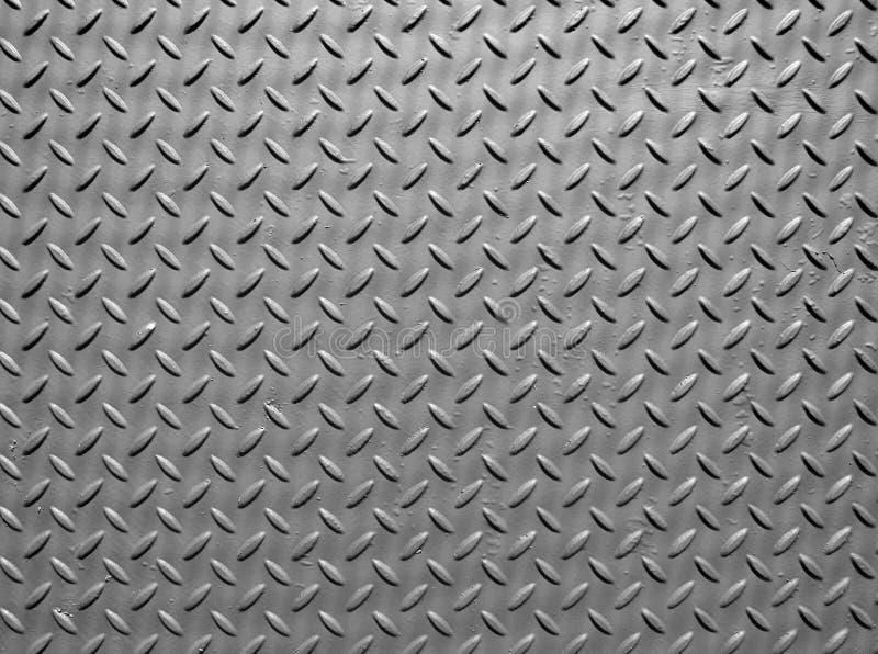 Di piastra metallica d'acciaio grigio con struttura di struttura della pittura e del modello del diamante industriale fotografia stock libera da diritti