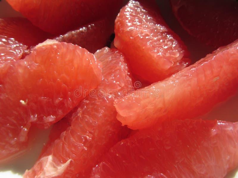 Di Ruby Red Grapefruit Segments ricco d'antiossidante fotografia stock libera da diritti