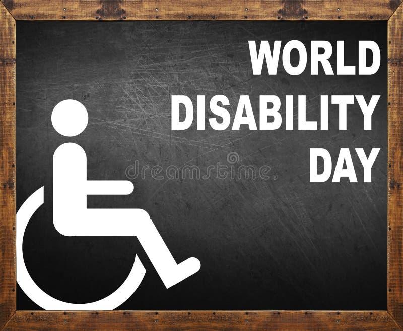 Dia da inabilidade do mundo escrito no quadro-negro imagens de stock royalty free