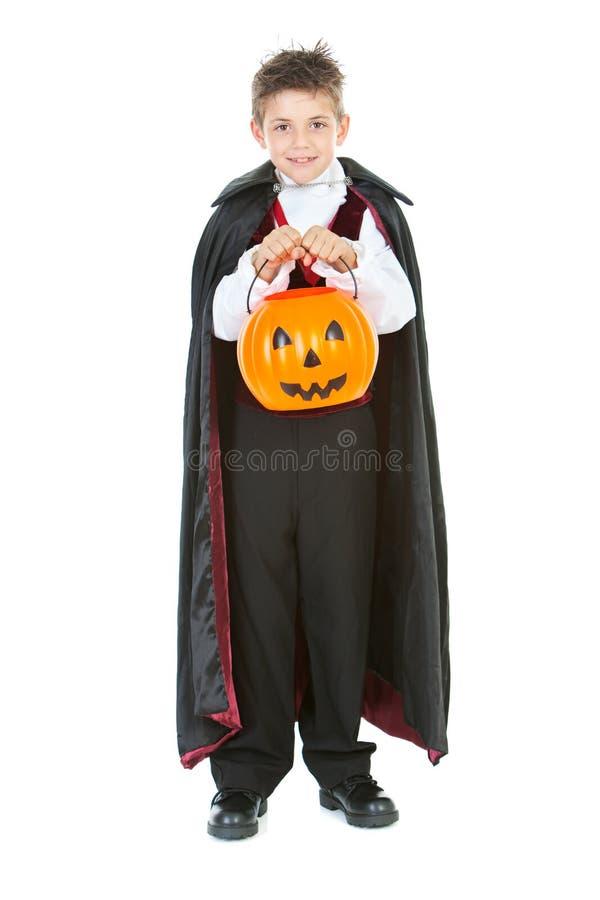 Dia das Bruxas: Truque ou tratamento do menino do vampiro imagem de stock royalty free