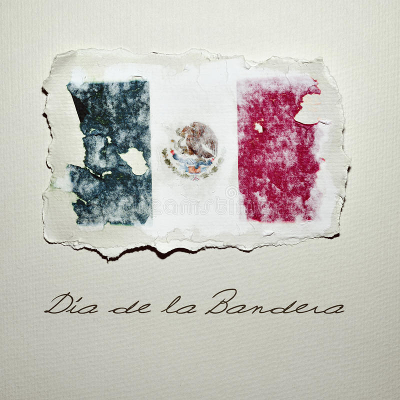 Dia de la Bandera, Flag Day in Mexico. The flag of Mexico in an aged piece of paper and the text Dia de la Bandera, Flag Day in written in Spanish, on an off royalty free stock photography