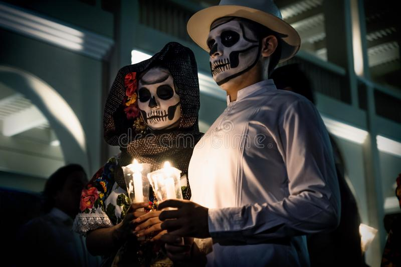 Dia de los muertos Catrina dancer couple portrait waiting in front of Palacio Municipal de Merida, Mexico. Merida, Mexico - October 29 2018: Painted dancers royalty free stock images