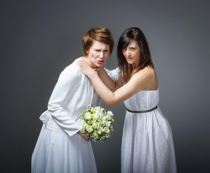 Dia do casamento em uma resolução de problemas da esposa imagem de stock