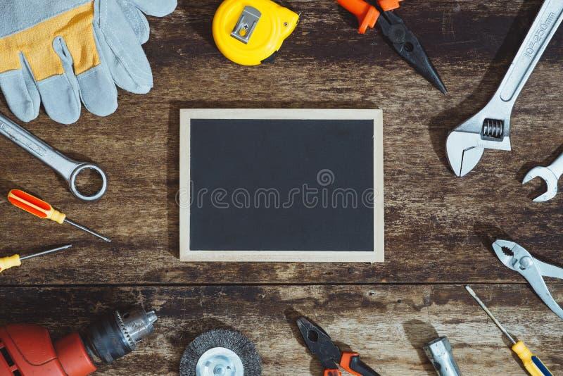 Dia do Trabalhador Ferramentas da construção com espaço da cópia fotografia de stock