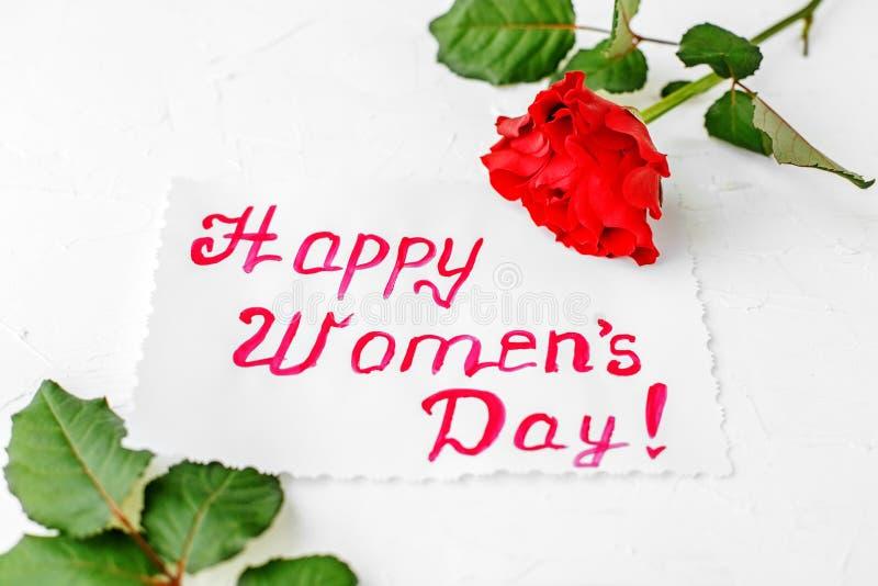 Dia feliz do ` s das mulheres Cumprimentos com rosas imagem de stock royalty free