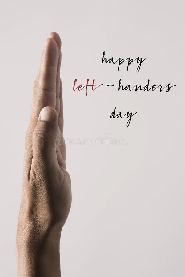 Dia feliz dos canhotos da mão esquerda e do texto foto de stock