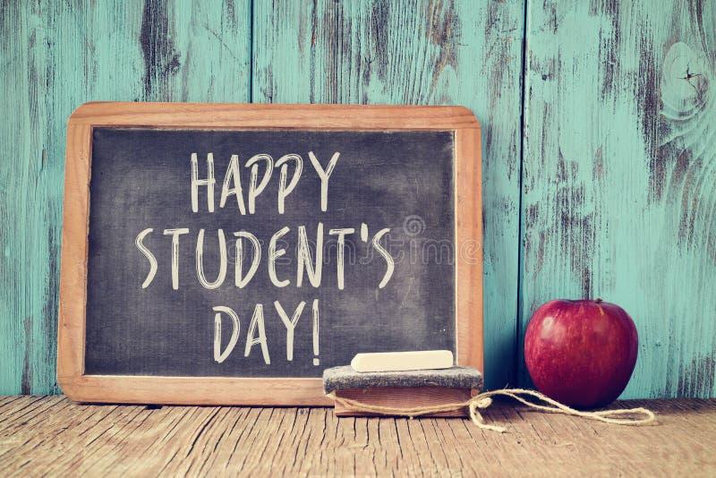 Dia feliz dos estudantes do texto em um quadro foto de stock