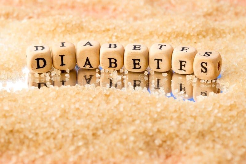 Diabète - dans les caractères gras en bois avec des granules de sucre sur la MIR photo stock