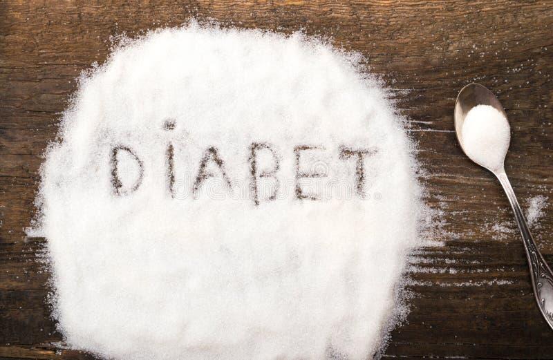 Diabet tecken som göras av grynigt socker arkivfoton