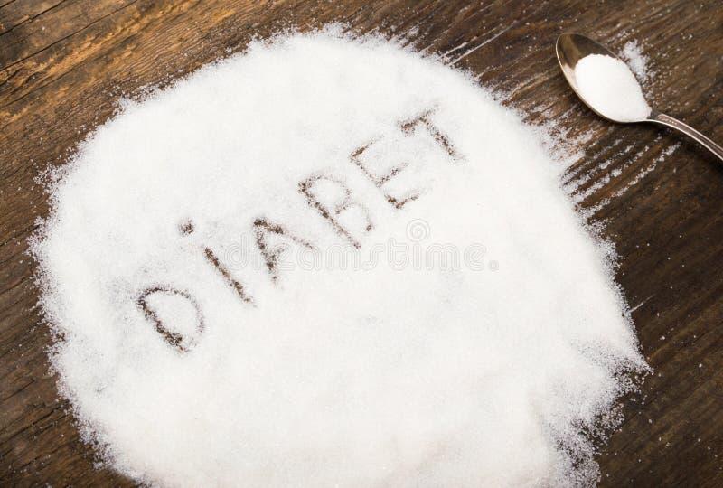 Diabet tecken som göras av grynigt socker royaltyfri fotografi