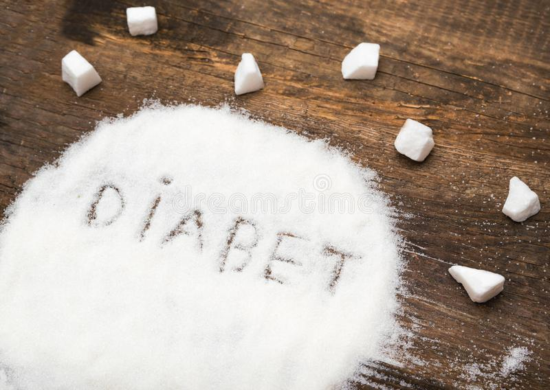 Diabet tecken som göras av grynigt socker fotografering för bildbyråer