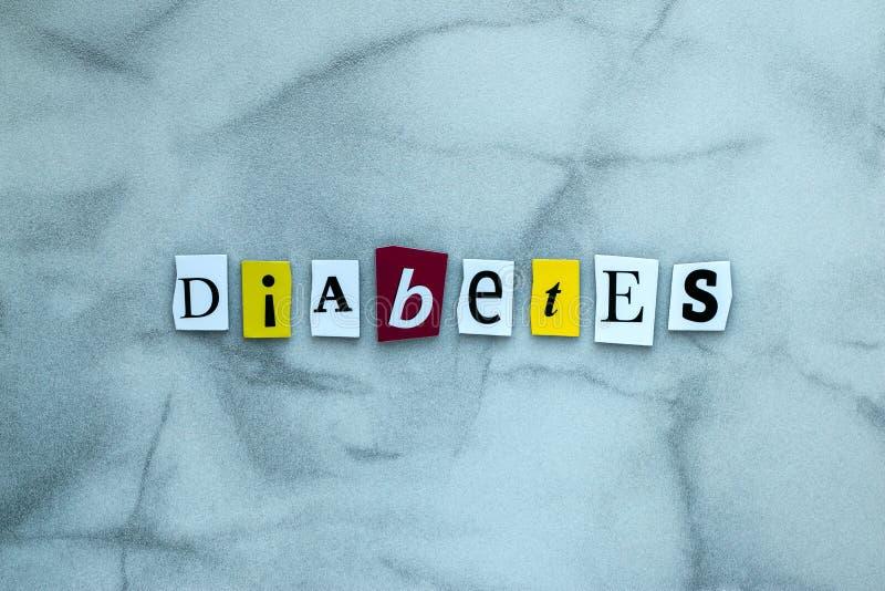 Diabete di parola delle lettere tagliate su fondo grigio per progettazione dell'insegna Concetto diagnostico Titolo - diabete Una fotografie stock libere da diritti