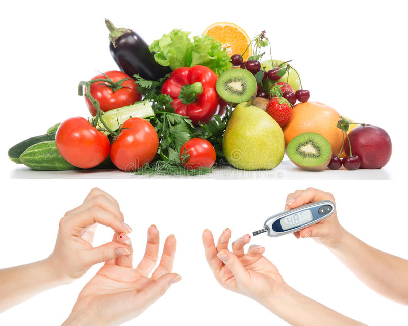 Diabetes concept glucose meter in hand and healthy organic food stock image
