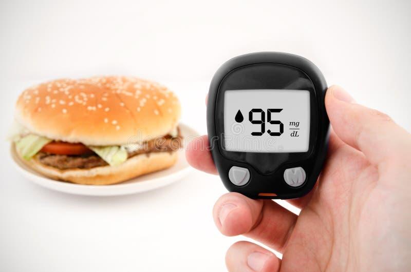 Diabetes doing glucose level test. royalty free stock photo