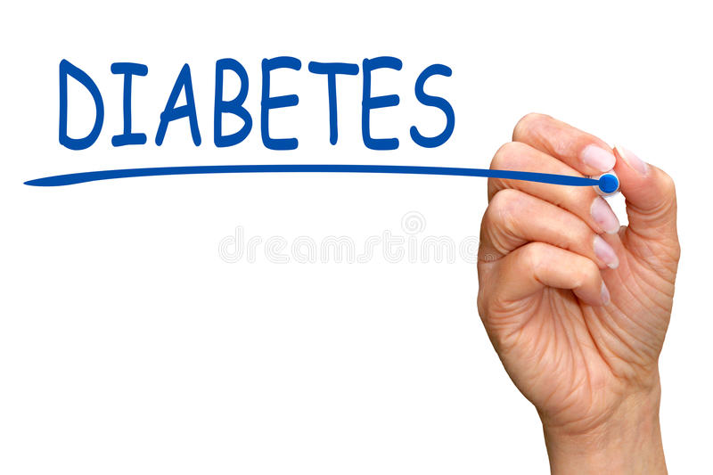 Diabetes - female hand with blue marker writing text royalty free stock images
