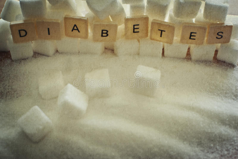 Diabetes. Lot of sugar cubes and diabetes stock images