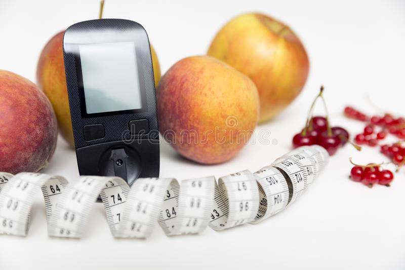 Diabetes monitor, diet and healthy food eating nutritional concept with clean fruits with diabetic measuring tool kit ans royalty free stock photography