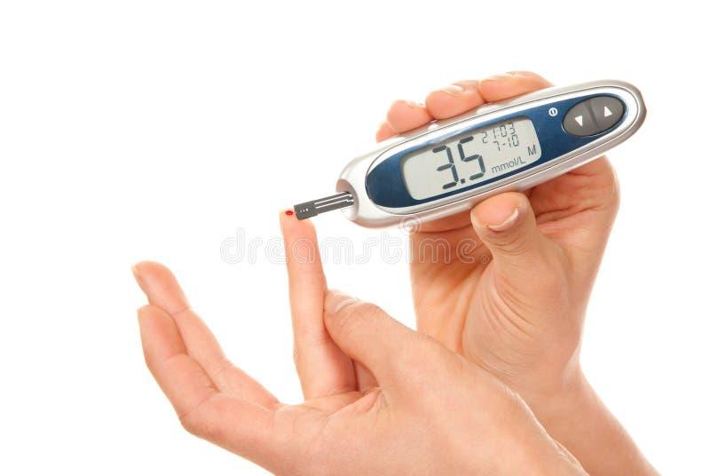 Diabetes patient measure glucose level blood test stock photography