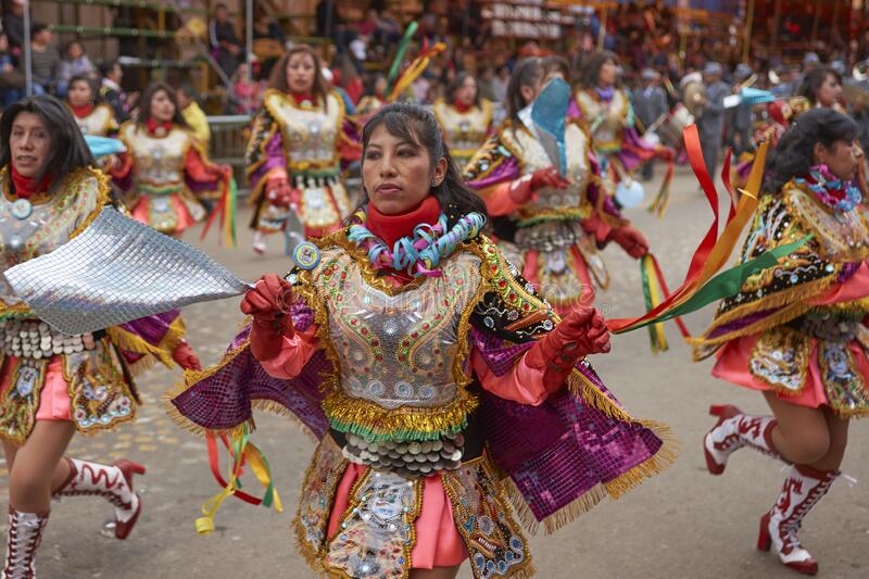 Diablada dancers at the Oruro Carnival in Bolivia. Diablada dancers in ornate costumes parade through the mining city of Oruro on the Altiplano of Bolivia during royalty free stock image