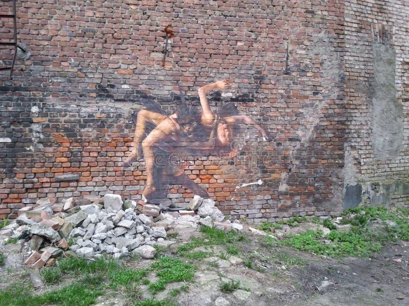 Diable captivant une femme à l'enfer photographie stock