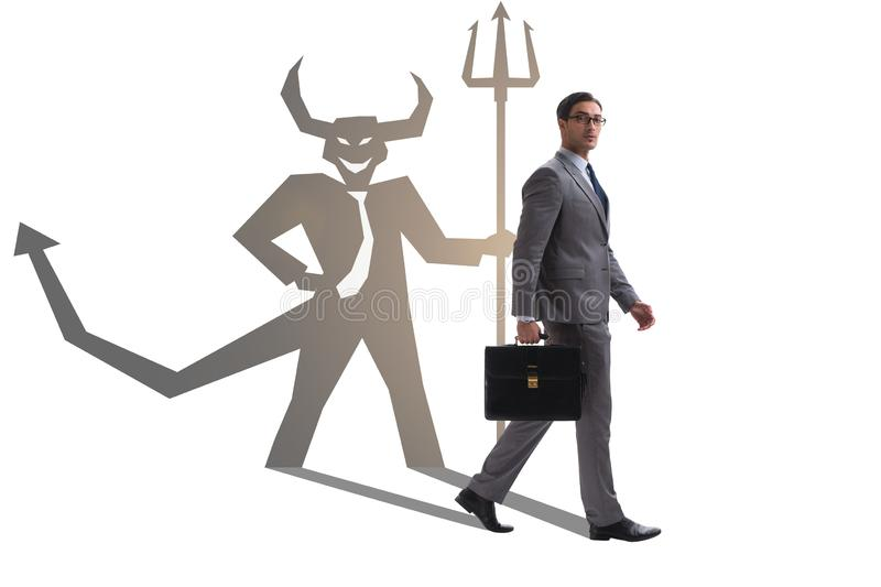 Diable se cachant dans l'homme d'affaires - concept d'alter ego photos libres de droits