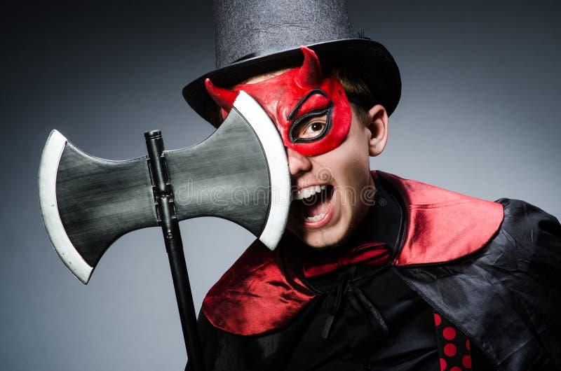 Download Diablo divertido contra foto de archivo. Imagen de horror - 41912714
