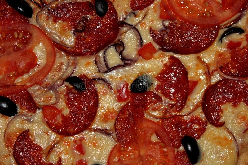 Diablo pizza with olives, smoked sausage stock photo