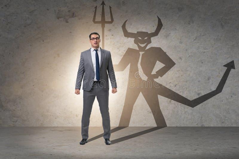 Diablo que oculta en el hombre de negocios - concepto del alter ego fotografía de archivo libre de regalías