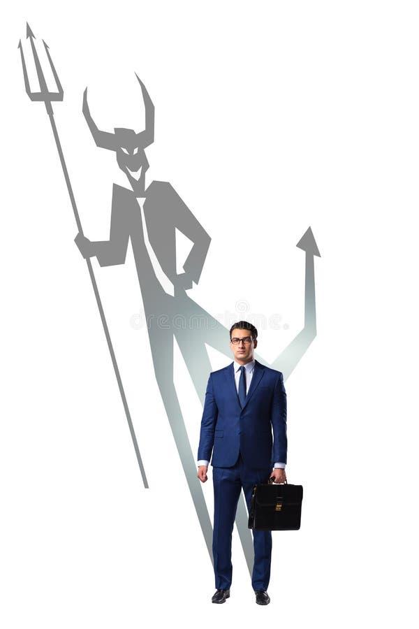 Diablo que oculta en el hombre de negocios - concepto del alter ego imagen de archivo